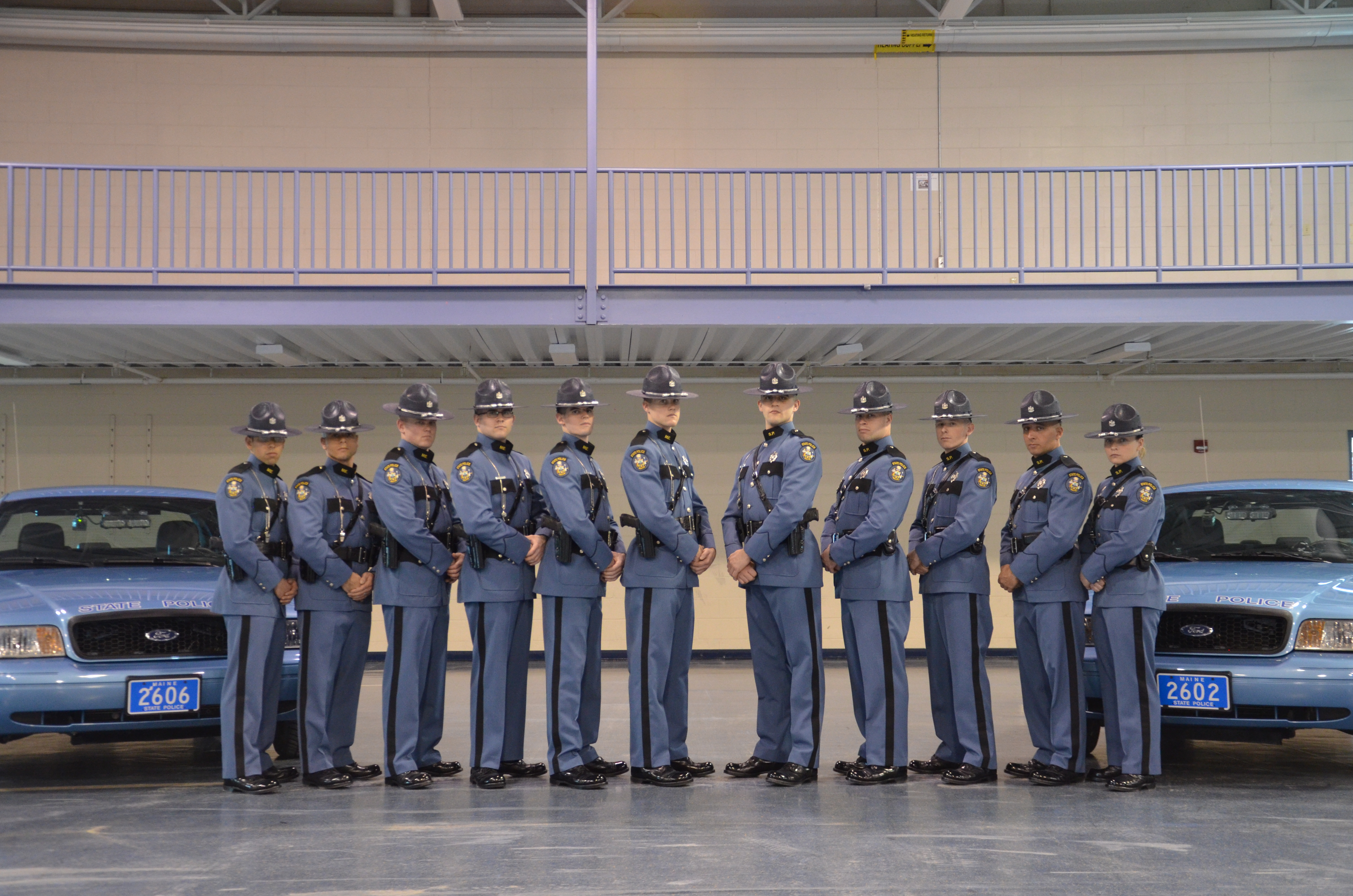 Maine State Troopers and cruisers